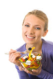 Woman eating salad, isolated Stock Photos