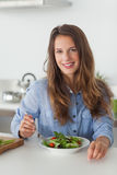 Woman eating a salad Stock Photos