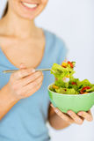 Woman eating salad with vegetables Stock Image