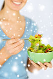 Woman eating salad with vegetables Stock Images