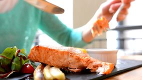 Woman eating salmon in restaurant stock footage
