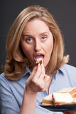 Woman eating a sandwich Stock Photo