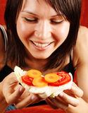 Woman eating sandwich Royalty Free Stock Images