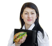 Woman eating sandwich Stock Photos