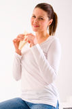 Woman eating a sandwich Stock Photography