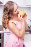 Woman eating a sandwich Stock Photos