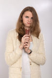 Woman eating sausage Stock Photos