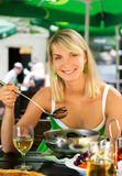 Woman eating seafood Stock Images