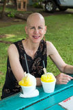 Woman eating shave ice Kauai Hawaii Royalty Free Stock Images