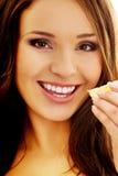 Woman eating shellfish. Royalty Free Stock Image