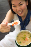 Woman eating shrimp Stock Image