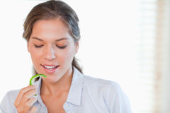 Woman eating a slice of pepper Stock Photos