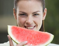 A woman eating a slice of watermelon Royalty Free Stock Images