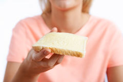 Woman Eating Slice Of White Bread With Margarine. Close Up Of Woman Eating Slice Of White Bread With Margarine Royalty Free Stock Images