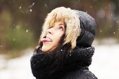 Woman eating snowflakes royalty free stock photos
