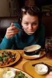 Woman eating soup Royalty Free Stock Photography