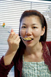 Woman eating spaghetti Stock Photo