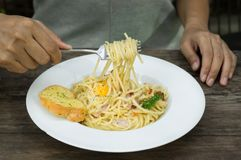 Woman eat spaghetti and garlic bread. Stock Photos