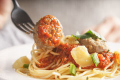 Woman eating spaghetti with meatballs Royalty Free Stock Photography