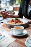 Woman eating spaghetti Stock Image