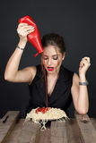 Woman eating spaghetti at wooden table Stock Images