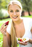Woman eating strawberries Royalty Free Stock Image
