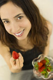 Woman eating strawberries Royalty Free Stock Photos