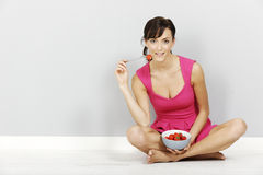 Woman eating strawberries Stock Photo