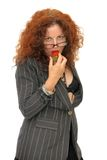 Woman eating a strawberry Stock Image