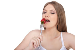 Woman eating strawberry Royalty Free Stock Photo