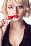 Woman eating a strawberry Royalty Free Stock Photography