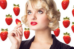 Woman  eating a strawberry Stock Photo