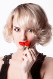 Woman   eating a strawberry Royalty Free Stock Photo