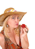 Woman eating strawberry. Stock Images