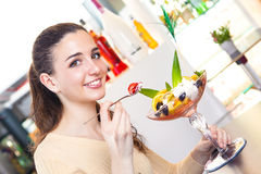 Woman eating a strawberry and ice cream dessert Royalty Free Stock Image