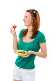 Woman eating strawberry and smiling Stock Photos