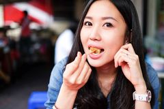 Woman eating Chinese steamed dumpling. Woman eating street food Chinese steamed dumpling Royalty Free Stock Photo