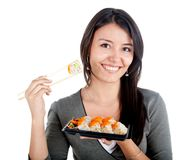 Woman eating sushi Stock Image