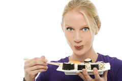 Woman eating sushi Stock Photo