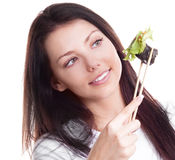 Woman eating sushi Stock Photography