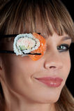 Woman  eating a sushi Stock Photography