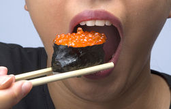 Woman eating sushi Royalty Free Stock Image