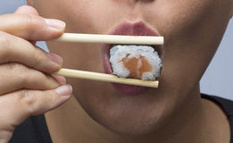 Woman eating sushi Royalty Free Stock Photo