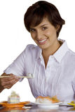 Woman eating sushi with chopsticks, cut out stock photos