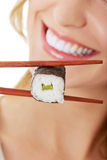 Woman eating sushi Royalty Free Stock Images