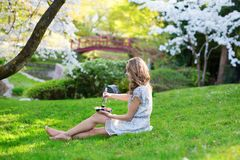 Woman eating sushi in Japanese park Stock Image