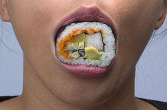 Woman eating sushi Royalty Free Stock Photography