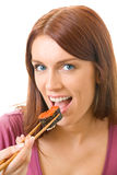 Woman eating sushi roll Stock Photography