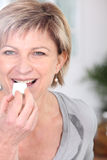 Woman eating sweet Royalty Free Stock Photography