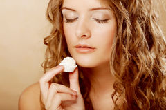 Woman eating sweet candy Royalty Free Stock Images